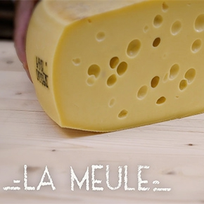 Why does Emmental cheese have holes in it ?